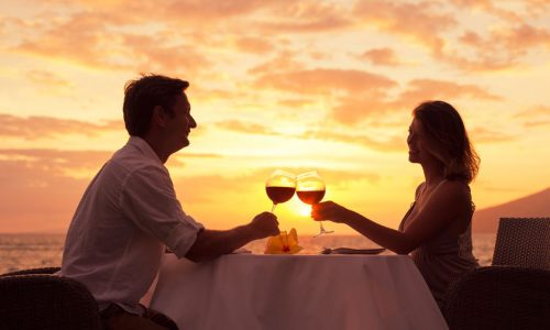 28878075 - couple sharing romantic sunset dinner on the beach